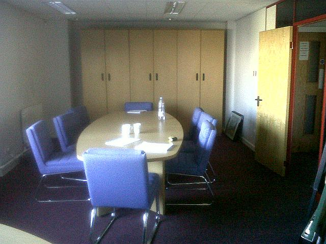 Boardroom furniture featuring used meeting room desk & chairs. This second hand office furniture is available immediately.